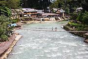 A foot bridge crosses the Bahorok River in the village of Bukit Lawang in northern Sumatra, Sumatra, Indonesia
