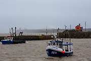 Fishing boats remain safe in Folkstone Harbour as Storm Ciara swept in on February 9th 2020 in Folkestone, United Kingdom. Amber weather warnings were put into place by the MET office as gusts of up to 90mph and heavy rain swept across the UK. An amber warning from the MET office expects a powerful storm that will disrupt air, rail and sea links travel, cancel sports events, cut electrical power and damage property.