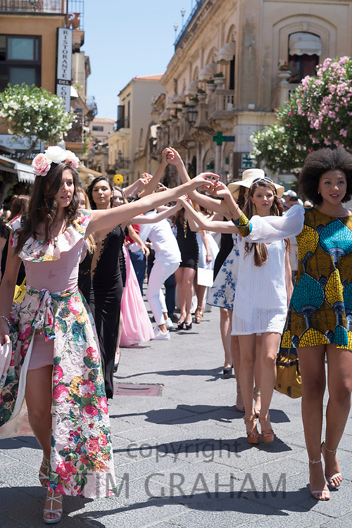 Glamorous models parade together in Piazza IX Aprile for  fashion show in the city of Taormina, East Sicily, Italy