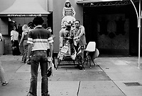 1979 Jesse Pizante, the official tourist photographer, at Grauman's Chinese Theater