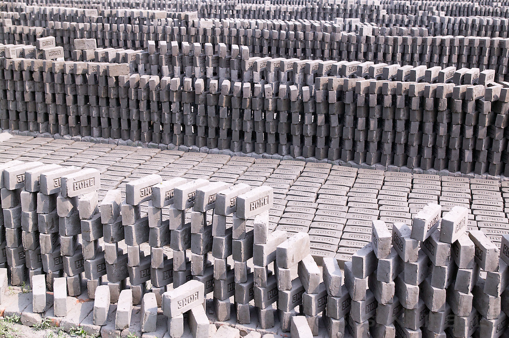 Stacks of bricks waiting to be fired at a brick making factory in Bangladesh