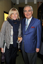 PATSY BAKER and HARRY WOOLF at a private view of  'A Diamond Jubilee Tribute - Faberge From A Private Collection' in aid of the charity Samaritans, held at Wartski, 14 Grafton Street, London on 14th May 2012.