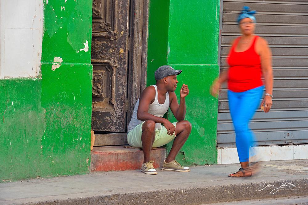 Street photography in central Havana- Open door with seated man, La Habana (Havana), Habana, Cuba