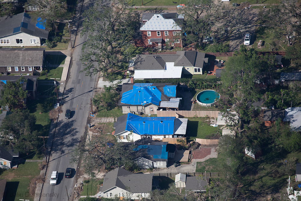 Blue tarps on damaged homes following Hurricane Delta, in Lake Charles, LA.