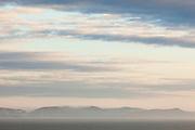 Dorset's Jurassic coastline partially enshrouded in dawn mists. England, UK.