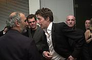 Alan Yentob and Hugh Grant. Talk pre-Bafta party. St. Martin's Lane Hotel. London. 24 February 2001. © Copyright Photograph by Dafydd Jones 66 Stockwell Park Rd. London SW9 0DA Tel 020 7733 0108 www.dafjones.com
