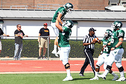 19 September 2015:  Frank Toland lifts Austin Wagner in the air in celebration of a Wagner touchdown during an NCAA division 3 football game between the Simpson College Storm and the Illinois Wesleyan Titans in Tucci Stadium on Wilder Field, Bloomington IL