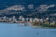 Evening view of Ambleside Park, English Bay, and condo/apartment towers along Marine Drive in West Vancouver, British Columbia, Canada.  Photographed from Prospect Point in Vancouver's Stanley Park.