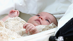 File photo dated 05/07/15 of Princess Charlotte in her Silver Cross pram following her christening. The Duke and Duchess of Cambridge will celebrate their daughter Princess Charlotte's second birthday on Tuesday.