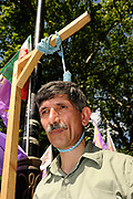 Supporters of the People's Mojahedin Organisation of Iran set up a mock hanging  opposite the Iranian embassy in London urging the UK government to break ties with Iran, July, 2010.