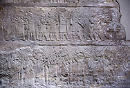 Stone relief sculptured panel of a the deportation of the Babylonians. From the palace of Ashurnasirpal II  , Niniveh, circa 645 BC. inv 19911  Louvre Museum , Paris .<br /> <br /> If you prefer to buy from our ALAMY PHOTO LIBRARY  Collection visit : https://www.alamy.com/portfolio/paul-williams-funkystock/ancient-assyria-antiquities.html  Refine search by adding background colour, place, subject, museum etc into the LOWER SEARCH WITHIN GALLERY box to <br /> <br /> Visit our ANCIENT WORLD PHOTO COLLECTIONS for more photos to download or buy as wall art prints https://funkystock.photoshelter.com/gallery-collection/Ancient-World-Art-Antiquities-Historic-Sites-Pictures-Images-of/C00006u26yqSkDOM