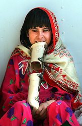 KABUL,AFGHANISTAN - SEPT. 11: An Afghan girl holds a leg brace she will learn to walk with at an ICRC hospital in Kabul, Afghanistan September 11,2002. While Americans are remembering the attack on the World Trade Center  one year ago today, most Afghans are trying to forget the decades old war which killed more than a million people here in Afghanistan. (Photo by Ami Vitale/Getty Images)