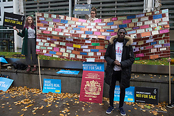 London, UK. 25 November, 2019. Samson Adeola, a former client of the Project for the Registration of Children as British Citizens (PRCBC), joins campaigners from Amnesty International UK's Children's Human Rights Network and PRCBC outside the Home Office to call on the British Government to stop selling children's rights. Currently, the Home Office charges £1,012 for citizenship applications, including for children living in poverty or local authority care, whilst the cost of processing an application is £372. Thousands of children with rights to British citizenship are prevented from claiming their rights due to excessive fees.
