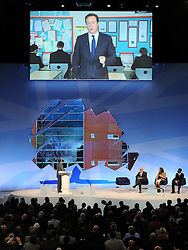 © Licensed to London News Pictures. 04/10/2011. MANCHESTER. UK. Prime Minister David Cameron addresses Michael Gove MP, Minister of State for Education, and the conference via a live link from Cedar Mount High School, which he was visiting this afternoon (04/10/11) The Conservative Party Conference at Manchester Central today, October 4, 2011. Photo credit:  Stephen Simpson/LNP