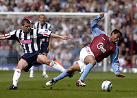 Fotball<br /> Premier League 2004/05<br /> Aston Villa v West Bromwich<br /> 10. april 2005<br /> Foto: Digitalsport<br /> NORWAY ONLY<br /> Aston Villa's Nolberto Solano (R) is brought down by West Brom's Paul Robinson