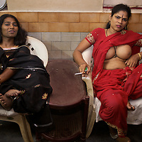 Aravanis in the lobby of a hotel while out for an evening in the town of Vilappuram during the week-long transgender gathering.  ..India's transexual community has a recorded history of more than four thousand years. Many consider the The Third Sex, also known as Aravanis, to posses special powers allowing them to determine the fate of others. As such, they are not only revered but despised and feared too. Resigned to the fringes of society, segregated and excluded from most occupations, many Aravanis are forced to turn to begging and sex work in order to earn a living. ..The annual transgender festival in the village of Koovagam, near Vilappuram, offers an escape from this often desolate existence. For some, the week-long partying and frenetic sex trade that culminates in the Koovagam festival is about fulfilling lustful desires. For others, the gathering provides a chance for transgenders to bond, share experiences, join the wider homosexual gay-community and coordinate their campaign for recognition and tackle the challenge of HIV/AIDS. ..It is the Indian state of Tamil Nadu that the eighty-thousand-strong Aravani community has made advances in their fight for rights. In 2009, the Tamil Nadu state government began providing sex-change surgery free of cost. The state has also offers special third-gender ration cards, passports and reserved seats in colleges. And 2008 the launch of Ippudikku Rose, a Tamil talk-show fronted by India's first transgender TV-host and the release of a mainstream Tamil film staring an Aravani in the lead-role. ..These advances clearly signal a victory for south India's transgenders, but they have also exposed deep divisions within the community. There is a very real gulf that separates the majority poor from their potentially influential but often reticent, upper-class sisters. ..Photo: Tom Pietrasik.Vilappuram District, Tamil Nadu. India.May 2009