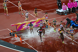 London, August 09 2017 . Athletes splash through the water in the women's 3,000m steeplechase heats on day six of the IAAF London 2017 world Championships at the London Stadium. © Paul Davey.