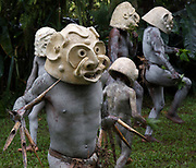 "THE MUDMEN OF THE WESTERN HIGHLANDS<br /> <br /> PAPUA NEW GUINEA is a land of Wig-Schools, Wig-Teachers and WigMen, impenetrable rain-forests, sweet potatoes and pigs. A land of the Cus-Cus, the Cassowary and thirty-eight species of Birds of Paradise.<br /> <br /> A land without sheep, goats, cows or milk. A land where there are no donkeys, horses or mules. No bicycles, mopeds and few cars; virtually no restaurants, bars, shops, electricity or roads. It is a land where there is no recreational sex, where a new-born girl is called a Shovel, a boy an Axe and where many adults have no birth certificates. It is perhaps one of the most untouched lands on earth.<br /> <br />  This bizarre way of life is found in the Highlands of Papua New Guinea, a country comprising more than 2000 indigeneous clans, including the Mudmen of the Waghi Valley.  To find this clan, you need to travel  to the Highlands town of Mt Hagen. Although it's the third largest town in the country it has a reputation of being ""the wild frontier' of the Highlands and more often is referred to as simply Hagen, a German name that acknowledges the presence of Lutheran missionaries who settled in the area almost a century ago. Compared with the intense heat and humidity of the coastal region, Hagen has a comfortable alpine climate and though it rains an average of 3800mm a year, there are few mosquitoes and consequently no malaria. Throughout Papua New Guinea, language is an issue. More than 800 different languages are spoken, 12% of the world's indigeneous languages, and very often adjoining clans are unable to understand the language spoken by their neighbours just a few kilometres away. Some of these languages are spoken by just 5000. <br /> <br /> For centuries the Highlands peoples of Papua New Guinea fought over land, women and pigs. Sorcery and battle skills could elevate a clan to Bigmanship, where the bigger the 'presentation', the bigger the man. Clans therefore would paint their bodies and create fearsome masks as part of their psy"