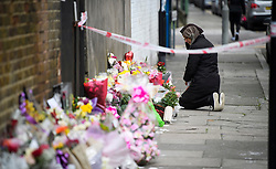 © Licensed to London News Pictures. 04/04/2018. London, UK. An emotional woman places flowers on Chalgrove Road in Tottenham, north London where 17 year old Tanesha Melbourne was shot dead. A recent spree of killings in the capital has taken the murder toll for the year so far to 48. Photo credit: Ben Cawthra/LNP