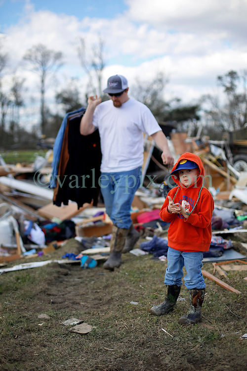 24 February 2016. Sugar Hill RV Park, Convent, Louisiana.<br /> Scenes of devastation following a deadly EF3 tornado touchdown. 2 confirmed dead. <br /> Zachary Brown and his 4 yr old son Garrett recover all they can from their destroyed trailer.<br /> Photo©; Charlie Varley/varleypix.com