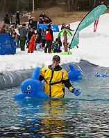 Andrew Mozier is ready to help skiers and riders as they attempt to skim the pond during Gunstock Mountain's BYODC event on Saturday.     (Karen Bobotas/for the Laconia Daily Sun)