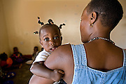 A baby arrives at the Miles2Smiles Welfare Centre in Kalerwe market, Kampala, Uganda. The centre is a day care and welfare service for market vendors with babies and infants aged 6 months to 5 years old.