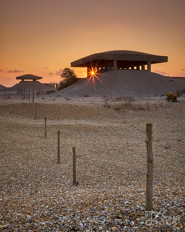 The Pagodas of the secret AWRE testing facility at Orford Ness in silhouette against the sunrise