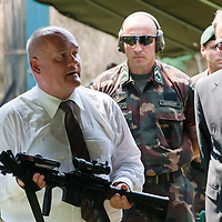 Csaba Hende Defense Minister for Hungary presents his shooting skills with a US made M4 rifle during the presentation of the Coalition Support Fund for Hungary by the US military in Szolnok, Hungary on July 18, 2011. ATTILA VOLGYI