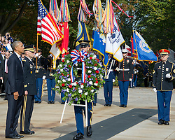 United States President Barack Obama, left, and US Army Major General Bradley A. Becker, Commander, US Army Military District of Washington, left center, stand at attention during a wreath-laying ceremony at the Tomb of the Unknown Soldier at Arlington National Cemetery in Arlington, Virginia on Veteran's Day, Friday, November 11, 2016.<br /> Credit: Ron Sachs / Pool via CNP