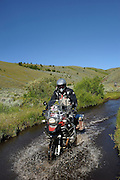 Ride leader Jim Hyde crossing a low water stream near Morrison Lake in the Montana Rockies.