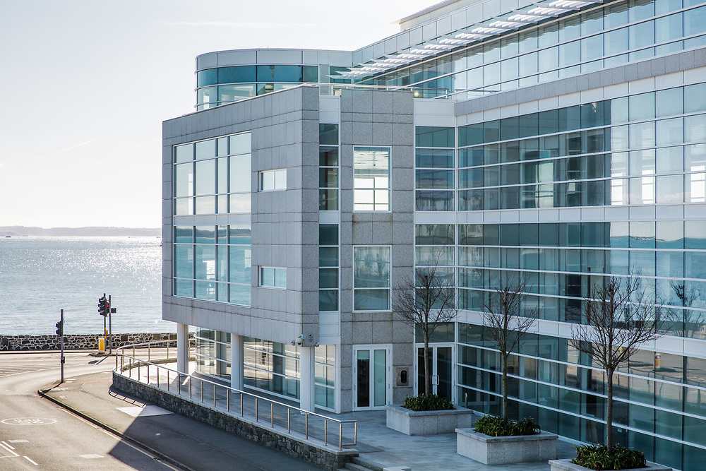 Corporate Offices overlooking the sea in their absolute beachfront location in the offshore finance and business district of St Peter Port, Guernsey, CI