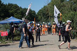 Harefield, UK. 26 June, 2020. Activists from HS2 Rebellion and Extinction Rebellion UK pass a HS2 road closure as they take part in a 'Rebel Trail' hike along the route of the HS2 high-speed rail link. The activists, who departed from Birmingham on 20th June and will arrive outside Parliament in London on 27th June, are protesting against the environmental impact of the high-speed rail link and questioning the viability of the £100bn+ project.