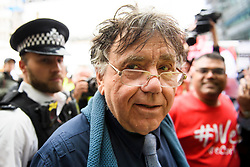 © Licensed to London News Pictures. 04/09/2018. London, UK. Leftwing activist PETER WILLSMAN recieves a warm welcome form protestors as he arrives at Labour Party headquarters in London to attend a National Executive Committee meeting. The Labour Party's ruling body is expected to vote on whether to adopt, in full, the IHRA (International Holocaust Remembrance Alliance) definition of anti-Semitism. Photo credit: Ben Cawthra/LNP