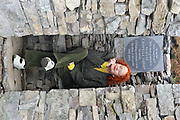 21-9-2012: Noelle Campbell Sharp, founder of the Cill Rialaigh Art project, (the restoration of a famine village in 1991) peers out from the 'Cairn' made and unveiled in her honour in Ballinskelligs, County Kerry on Friday. The villahe has housed thousands of artists from all over the world during the past 21 years. The Cairn, a pile of rock on a sacred space overlooks The Hogs Head and Scarriff Islands and will be used by artists for inspiration in their work..Picture by Don MacMonagle