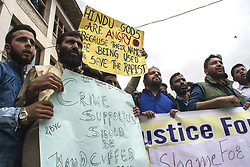 "April 14, 2018 - Srinagar, Jammu And Kashmir, India - Kashmir Muslim hold ply cards during a protest demanding justice for Asifa Bano. Gujjar, Bakarwal and Traders association, Staged protest today at Srinagar, the summer capital of Indian administered Kashmir. Protesters were demanding justice for eight year old Ashifa Bano who was raped and murdered in Kathua district of Jammu region, after being drugged and tortured for several days inside a Hindu temple.  Protesters during the protest said, ""This is a protest against the rape, torture and murder of an innocent girl, Ashifa Bano. This is a protest against the blatant attempts to communalise the case by Indian leaders. (Credit Image: © Masrat Zahra/SOPA Images via ZUMA Wire)"