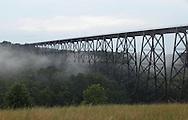 Salisbury Mills, New York - Fog moves under the Moodna Viaduct railroad trestle on July 21, 2010.