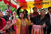 Weavers Fields, Bethnal Green, London. Boishakhi Mela, celebration for Bangladesh New Year. Bangladeshi radio station plays live music on its stall