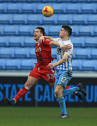 18 February 2017 - Skybet League One - Coventry City v Gillingham - Mark Byrne of Gillingham battles with Callum Reilly of Coventry City - Photo: Paul Roberts / Offside