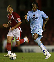 Photo: Rich Eaton.<br /> <br /> Bristol City v Manchester City. Carling Cup. 29/08/2007. Man City's Emile Mpenza (r) attacks,