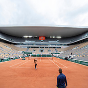 PARIS, FRANCE May 26. Naomi Osaka of Japan watched by coach Wim Fissette and Ashleigh Barty of Australia practicing on Court Philippe-Chatrier during a practice match in preparation for the 2021 French Open Tennis Tournament at Roland Garros on May 2pm 6th 2021 in Paris, France. (Photo by Tim Clayton/Corbis via Getty Images)
