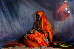Kadija visits Fatna Adem, 28, just a few days after she helped her give birth to a baby girl in a village in Barentu, Eritrea August 30, 2006.    (Photo by Ami Vitale)