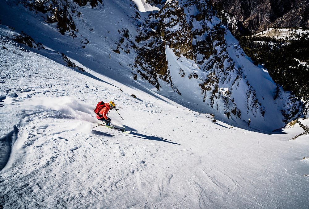 Caroline Gleich drops into the exit couloir after backing down from her first objective for the day. Wind loading made the intended line unsafe for the day. Wasatch Mountains, Utah.