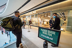 Edinburgh, Scotland, UK. 24 June 2021. First images of the new St James Quarter which opened this morning in Edinburgh. The large retail and residential complex replaced the St James Centre which occupied the site for many years.  Queue outside Pull & Bear shop. Iain Masterton/Alamy Live News