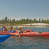 Yellowstone National Park. Kayakers on Yellowstone Lake, beside West Thumb Geyser Basin, Wyoming