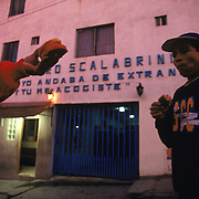 A migrant offers his breakfast to another outside the Casa Del Migrante shelter in Tijuana, Mexico, a temporary home for stranded and destitute migrants attempting to cross the border or for those recently deported. Migrants are forced out of the shelter at dawn to look for work. Please contact Todd Bigelow directly with your licensing requests. PLEASE CONTACT TODD BIGELOW DIRECTLY WITH YOUR LICENSING REQUEST. THANK YOU!