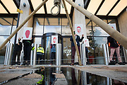 Environmental activists from Extinction Rebellion use a tripod, noose and fake oil to mark the 25th anniversary of the killings of the Ogoni Nine outside the Shell Centre on 10 November 2020 in London, United Kingdom. The Ogoni Nine, leaders of the Movement for the Survival of the Ogoni People (MOSOP) including activist Ken Saro-Wiwa, were executed by the Nigerian government in 1995 after having led a series of peaceful marches involving an estimated 300,000 Ogoni people against the environmental degradation of the land and waters of Ogoniland by Shell and to demand both a share of oil revenue and greater political autonomy.