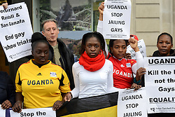 © Licensed to London News Pictures.18/11/2013. London, UK. Protesters hold up signs at the Uganda High Commission in London to support a retired expatriate British gay man, Bernard Randall, and his Ugandan partner Albert Cheptoyek, who are facing court action in the east African country.Photo credit : Peter Kollanyi/LNP