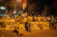 Barricades and checkpoints are built by pro-Morsi supporters in Nassr City, Cairo, to prevent opposition demonstrators or the military from entering the 'sit-in'