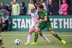 November 4, 2018 - Portland, OR, U.S. - PORTLAND, OR - NOVEMBER 04: Seattle Sounders midfielder Nicolás Lodeiro (10) attemps to dribble past Portland Timbers defender Zarek Valentin (16) during the Portland Timbers first leg of the MLS Western Conference Semifinals against the Seattle Sounders on November 04, 2018, at Providence Park in Portland, OR. (Photo by Diego Diaz/Icon Sportswire) (Credit Image: © Diego Diaz/Icon SMI via ZUMA Press)