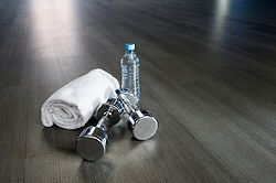 Close-up room empty towel barbell water bottle